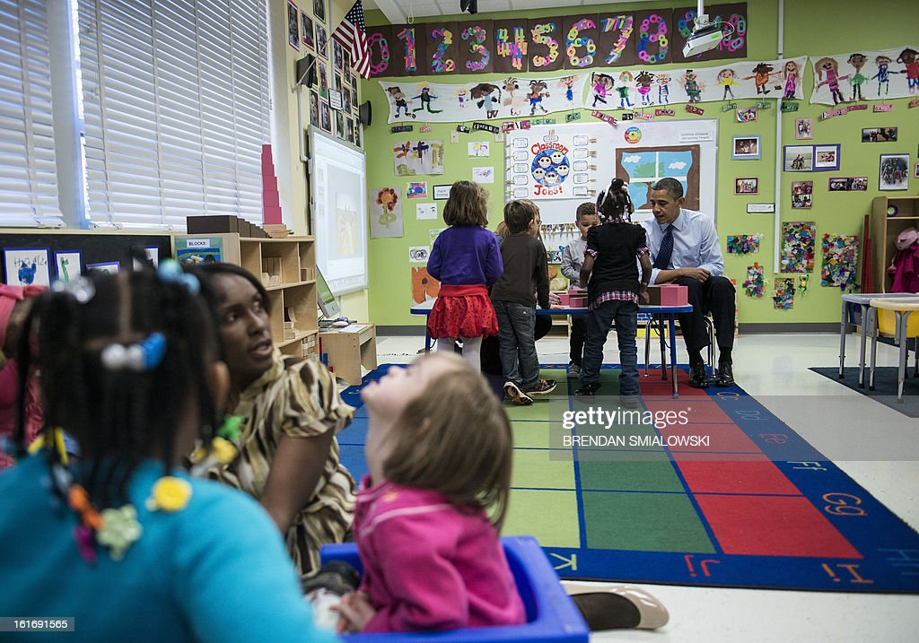 US President Barack Obama visits children at College Heights Early Childhood Learning Center February 14, 2012 in Decatur, Georgia. Obama is traveling to Georgia to promote economic and educational initiatives he spoke about in this week's State of the Union. AFP PHOTO/Brendan SMIALOWSKI