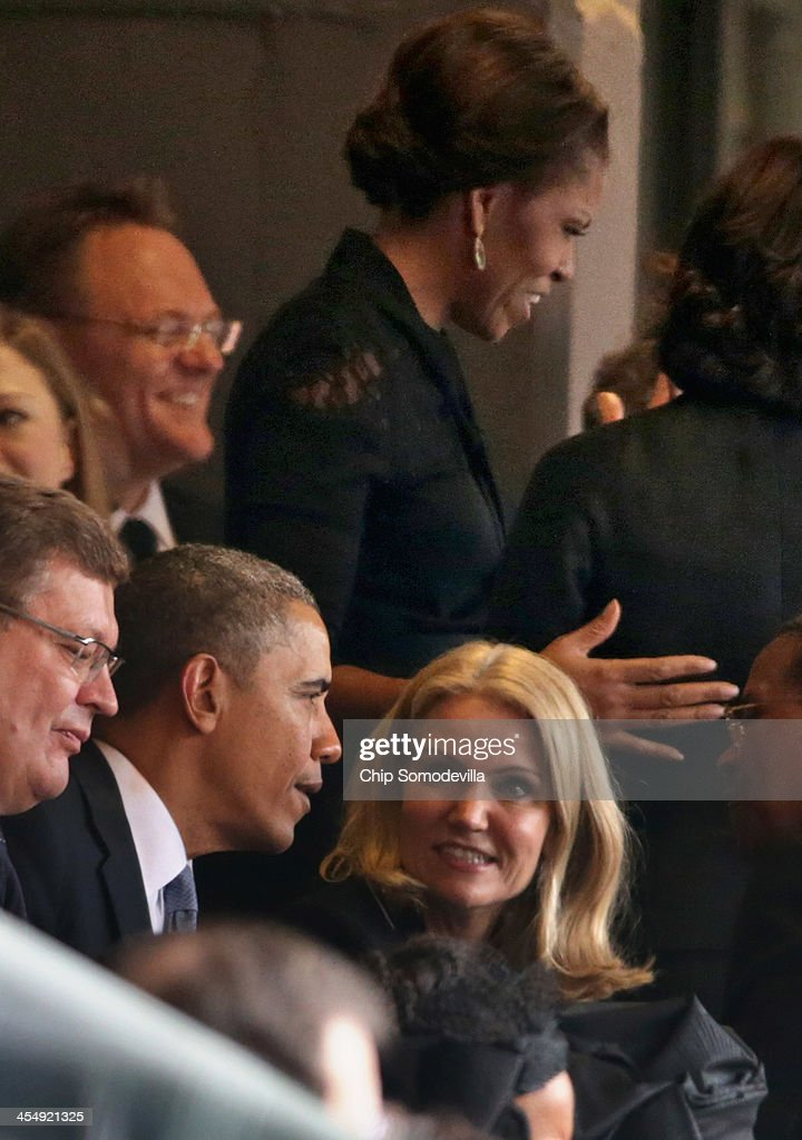 S President Barack Obama visits with Denmark's Prime Minister Helle Thorning Schmidt as first lady Michelle Obama visits with guests during the...