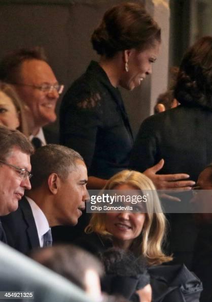 S President Barack Obama visits with Denmark's Prime Minister Helle Thorning Schmidt as first lady Michelle Obama visits with guests during the...