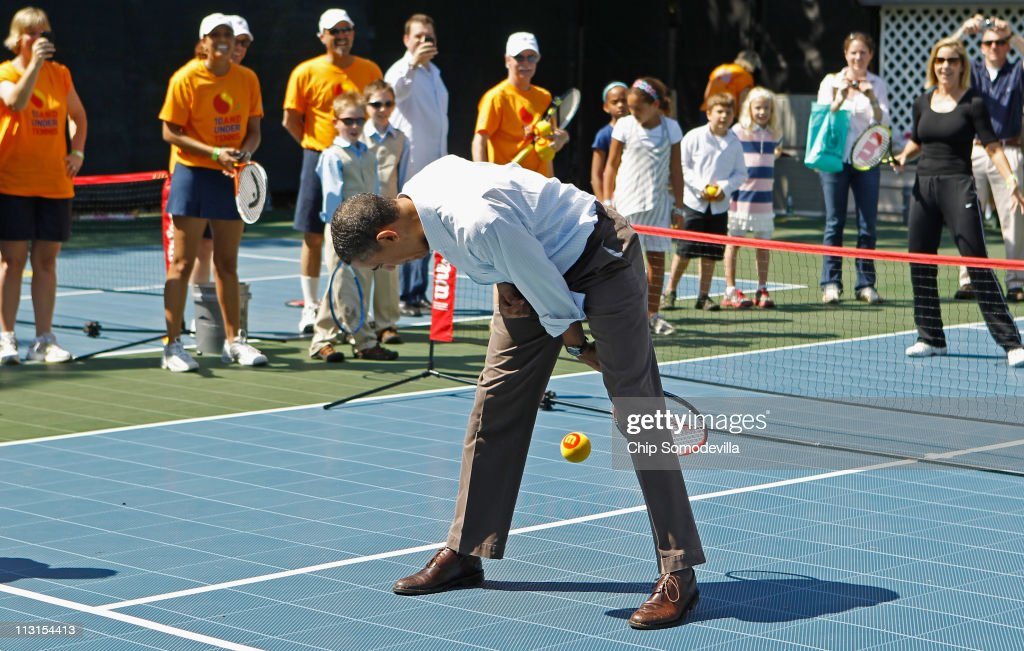 US President Barack Obama volleys a tennis ball between his legs while participating in a 'Let's Move' clinic with members of the NBA WNBA and the...