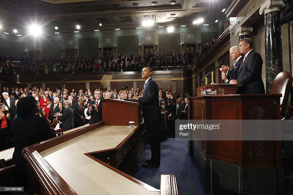 U.S. President <a gi-track='captionPersonalityLinkClicked' href=/galleries/search?phrase=Barack+Obama&family=editorial&specificpeople=203260 ng-click='$event.stopPropagation()'>Barack Obama</a> (C) waits to address a Joint Session of Congress at the U.S. Capitol September 8, 2011 in Washington, DC. Obama addressed both houses of the U.S. legislature to highlight his plan to create jobs for millions of out of work Americans.