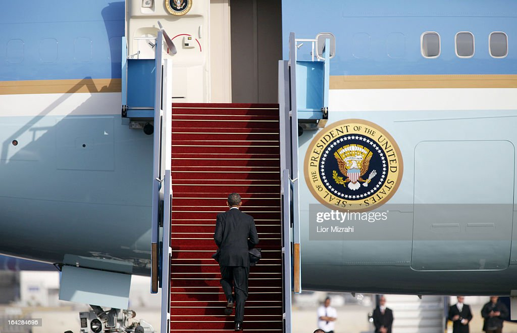 U.S. President Barack Obama walk up the steps of Air Force One prior to departing from Ben Gurion International Airport on March 22, 2013 in Lod' Israel. Obama concluded his first visit to Israel and West Bank after three-days of meetings with Israeli and Palestinian leaders.