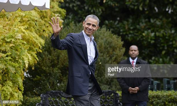 US President Barack Obama walks across the South Lawn before departing the White House on board Marine One November 29 2015 in Washington DC Nearly...
