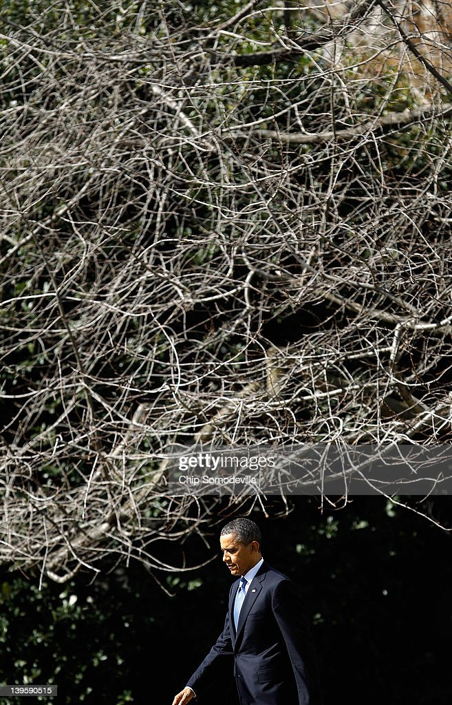 U.S. President Barack Obama walks across the South Lawn of the White House before boarding Marine One February 23, 2012 in Washington, DC. Obama is traveling to Miami, Florida, to talk about his administration's energy and economic policies and to attend campaign fundraisers.