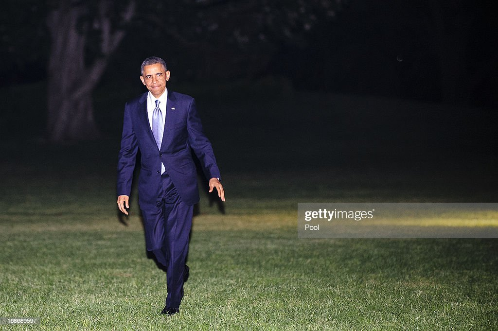 U.S. President <a gi-track='captionPersonalityLinkClicked' href=/galleries/search?phrase=Barack+Obama&family=editorial&specificpeople=203260 ng-click='$event.stopPropagation()'>Barack Obama</a> walks across the South Lawn of the White House after arriving aboard Marine One on May 13, 2013 in Washington, DC. The President was returning from New York City where he attended two DNC events at private residences and a joint DCCC/DSCC event at the Waldorf Astoria Hotel.