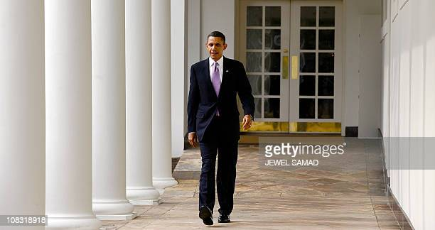 US President Barack Obama walks along the colonnade from the Oval Office at the White House in Washington DC on January 25 2011 A resurgent Obama...