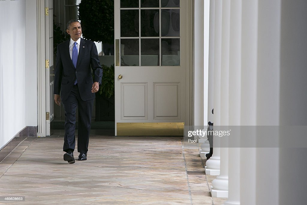 S President Barack Obama walks along the colonnade of the White House from the residence to the Oval Office before the State Of The Union speech on...