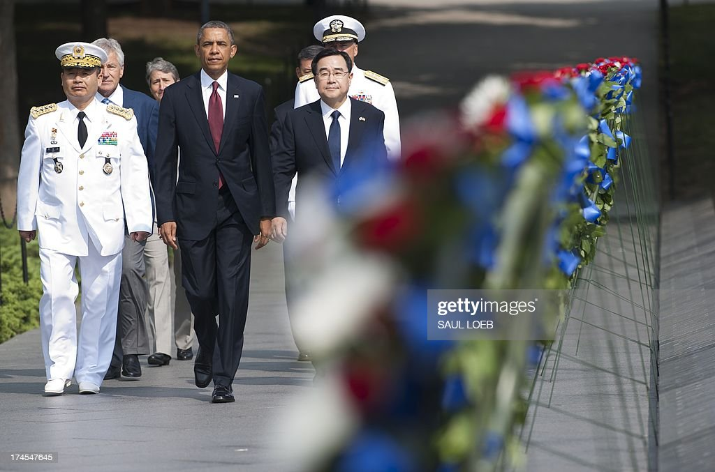 US President <a gi-track='captionPersonalityLinkClicked' href=/galleries/search?phrase=Barack+Obama&family=editorial&specificpeople=203260 ng-click='$event.stopPropagation()'>Barack Obama</a> walks alongside Korean General Jung Seung-jo (L), Chairman of Korea's Joint Chiefs of Staff, and Korean Special Envoy Kim Jung Hun (R), as well as other US and Korean officials, prior to laying a wreath at the Korean War Veterans Memorial to commemorate the 60th anniversary of the signing of the Armistice that ended the Korean War, during a ceremony in Washington, DC, July 27, 2013. AFP PHOTO / Saul LOEB