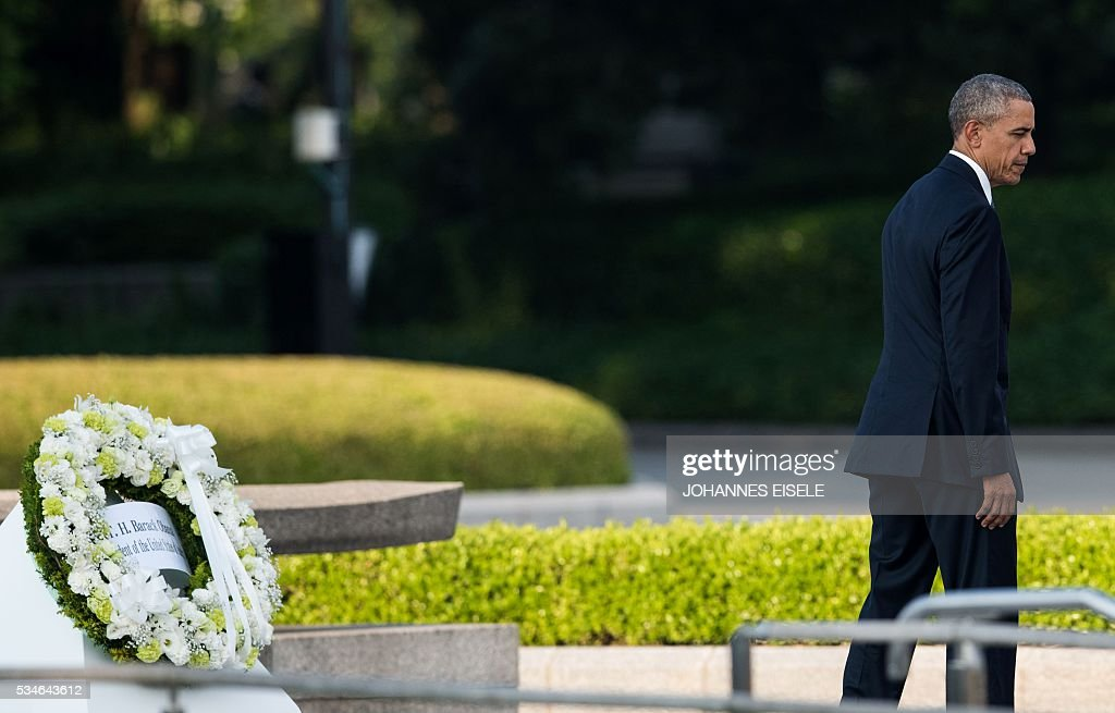 US President Barack Obama walks away after laying a wreath during a visit to the Hiroshima Peace Memorial Park in Hiroshima on May 27, 2016. Obama paid moving tribute on May 27 to victims of the world's first nuclear attack, during a historic visit to Hiroshima. / AFP / JOHANNES