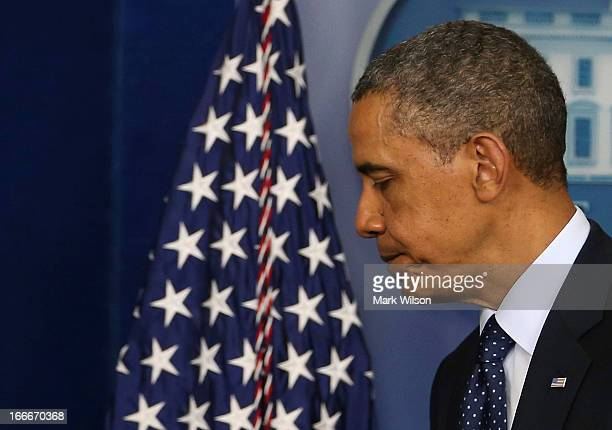 S President Barack Obama walks away after speaking about today's bombing at the Boston Marathon April 15 2013 in Washington DC Two people are...