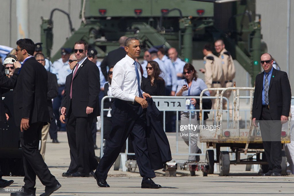 US President Barack Obama (C) walks away after visiting an Iron Dome missile battery (not seen) at the Ben Gurion Airport on March, 20, 2013 near Tel Aviv, Israel. This will be Obama's first visit as President to the region, and his itinerary will include meetings with the Palestinian and Israeli leaders as well as a visit to the Church of the Nativity in Bethlehem.