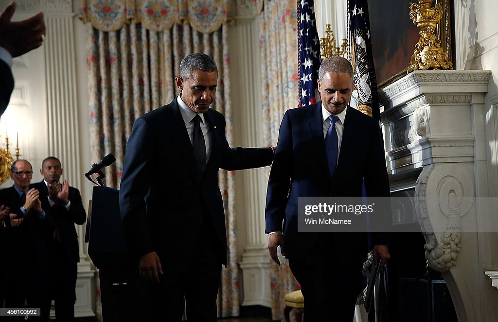 U.S. President <a gi-track='captionPersonalityLinkClicked' href=/galleries/search?phrase=Barack+Obama&family=editorial&specificpeople=203260 ng-click='$event.stopPropagation()'>Barack Obama</a> (L) walks away with Attorney General <a gi-track='captionPersonalityLinkClicked' href=/galleries/search?phrase=Eric+Holder&family=editorial&specificpeople=1060367 ng-click='$event.stopPropagation()'>Eric Holder</a> (R) after Holder announced his resignation at the White House September 25, 2014 in Washington, DC. Holder has been led the Department of Justice since the beginning of the Obama administration in 2009 and plans to remain in office until his successor is named.