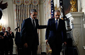 S President Barack Obama walks away with Attorney General Eric Holder after Holder announced his resignation at the White House September 25 2014 in...