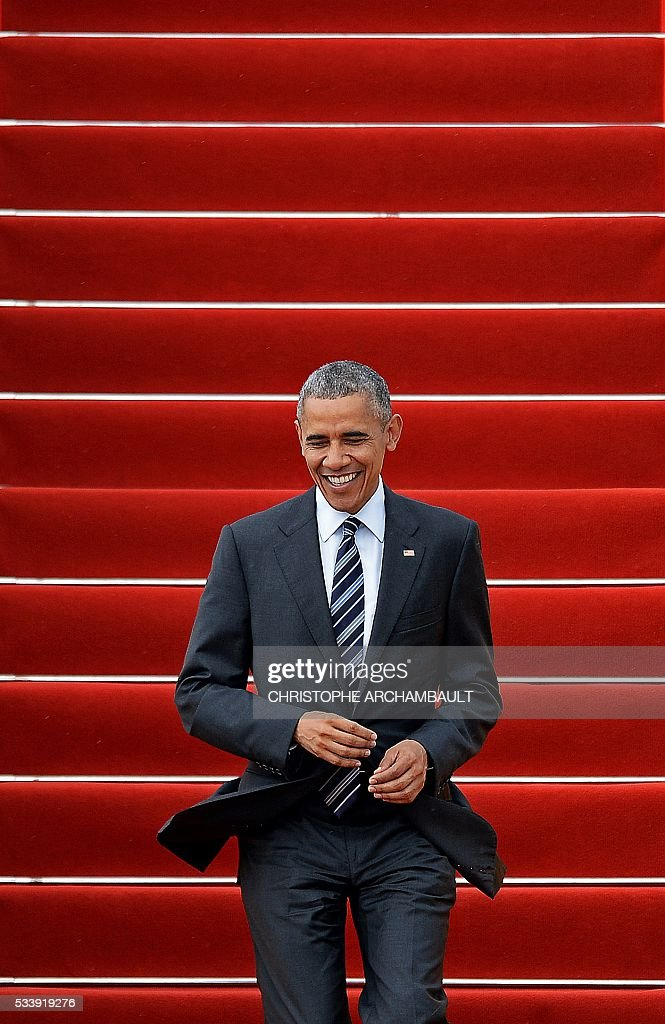US President Barack Obama walks down the stairs as he disembarks from Air Force One upon his arrival at the Tan Son Nhat airport in Ho Chi Minh City on May 24, 2016. Obama told communist Vietnam on May 24 that basic human rights would not jeopardise its stability, in an impassioned appeal for the one-party state to abandon authoritarianism. / AFP / CHRISTOPHE
