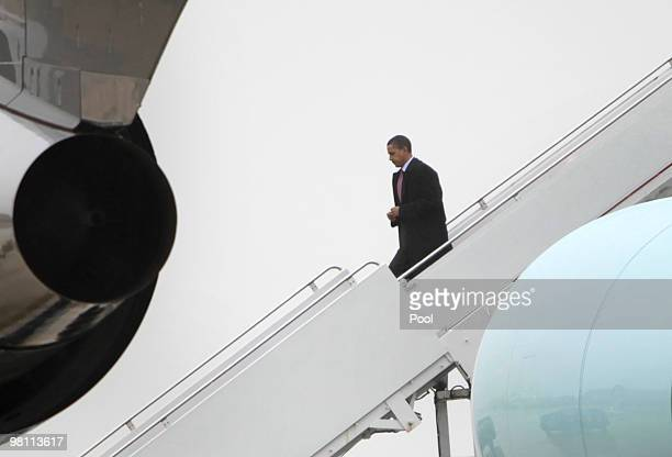 US President Barack Obama walks down the stairs of Air Force One upon his arrival to Andrews Air Force Base on March 29 2010 near Camp Springs...