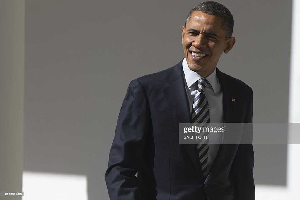 US President Barack Obama walks down the West Wing Colonnade at the White House in Washington, DC, February 12, 2013. Obama will deliver his first State of the Union address of his second term tonight at the US Capitol before a Joint Session of Congress. AFP PHOTO / Saul LOEB