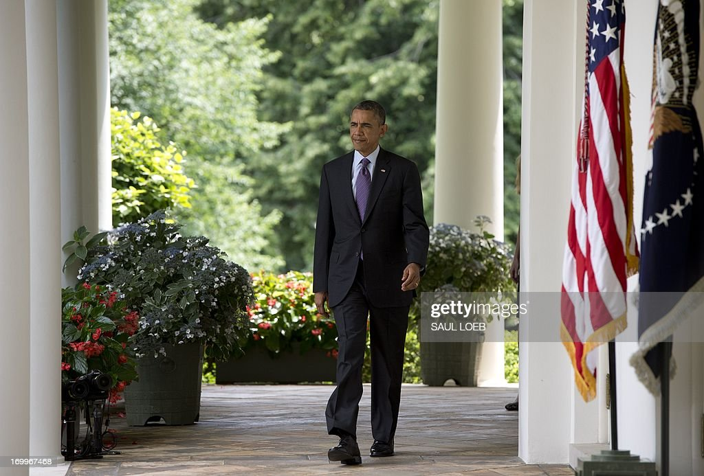 US President Barack Obama walks down the West Wing Colonnade to announce that current UN Ambassador Susan Rice will replace outgoing National Security Adviser Tom Donilon and Samantha Power will become the nominee for new UN Ambassador, in the Rose Garden of the White House in Washington, DC, June 5, 2013. AFP PHOTO / Saul LOEB