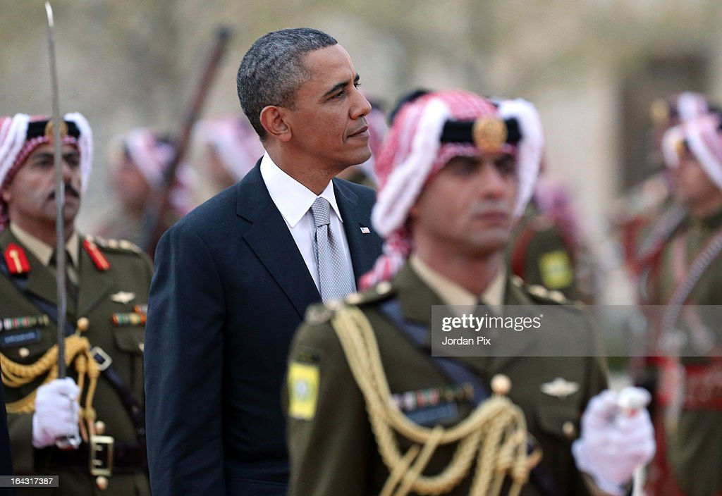 U.S. President Barack Obama (2nd L) walks during an honor guard Ceremony at the Al Hummar palace March 22, 2013 in Amman, Jordan. Jordan is the last stop on a four-day Mideast trip that included Israel and the West Bank.