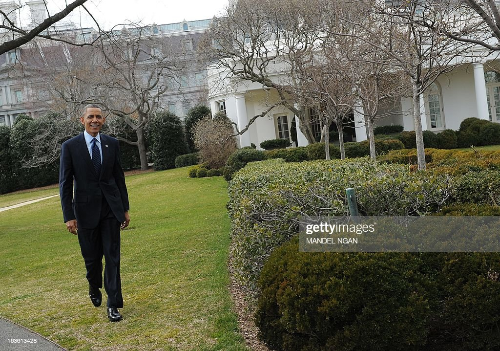 US President Barack Obama walks from his limousine upon return to the White House on March 13, 2013 in Washington, DC. Obama returned to the White Houe after travelling to Capitol Hill to meet with the House Republican Conference. AFP PHOTO/Mandel NGAN