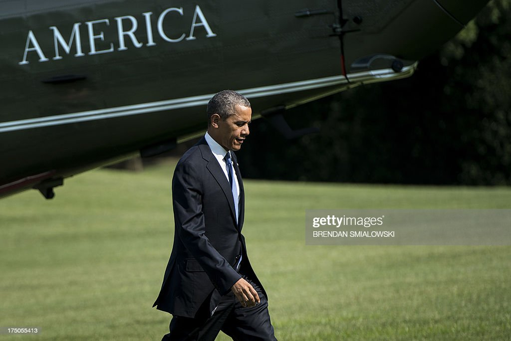 US President <a gi-track='captionPersonalityLinkClicked' href=/galleries/search?phrase=Barack+Obama&family=editorial&specificpeople=203260 ng-click='$event.stopPropagation()'>Barack Obama</a> walks from Marine One on the South Lawn of the White House on July 30, 2013 in Washington. Obama was returning from a day trip to Tennessee where he toured an Amazon Fulfillment Center. AFP PHOTO/Brendan SMIALOWSKI