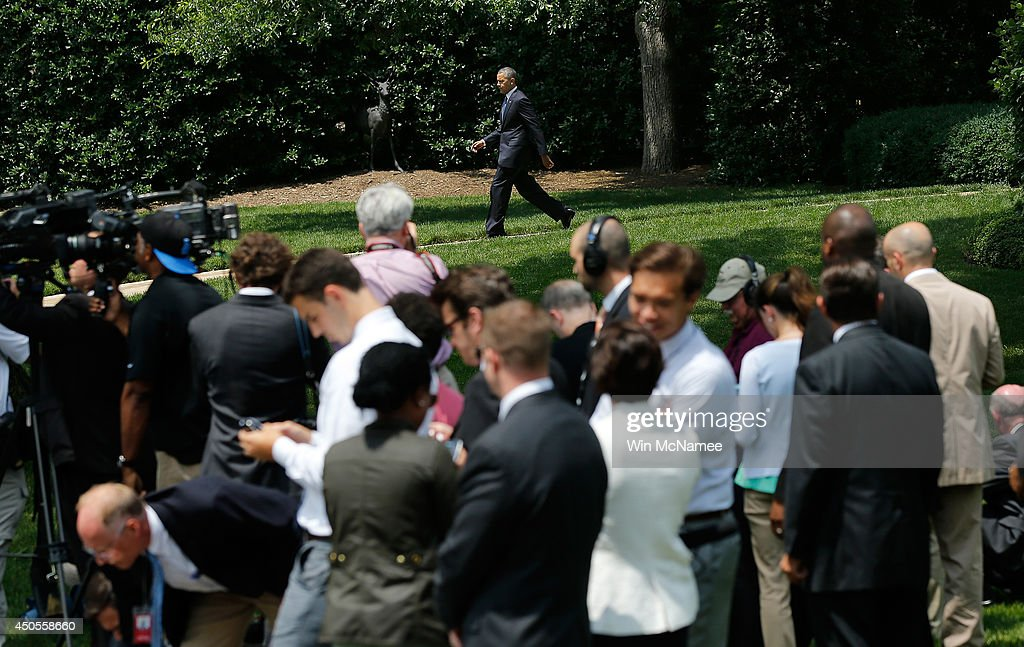 U.S. President Barack Obama walks from the Oval Office past waiting reporters and White House staff to make a statement on the situation in Iraq June 13, 2014 on the south lawn of the White House in Washington, DC. Obama said he will make a decision in the Òdays aheadÓ about the use of American military power to aid the Iraqi government in its battle against Islamic insurgents.