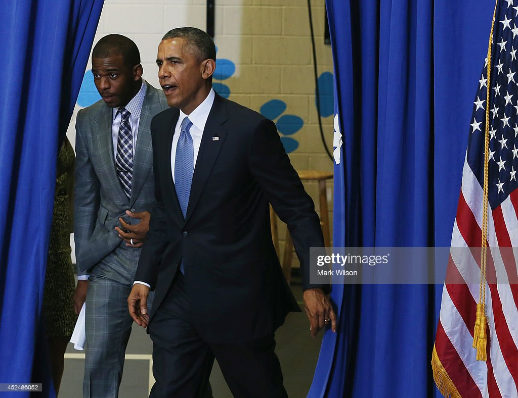 U.S. President <a gi-track='captionPersonalityLinkClicked' href=/galleries/search?phrase=Barack+Obama&family=editorial&specificpeople=203260 ng-click='$event.stopPropagation()'>Barack Obama</a> (R) walks into an event with NBA Basketball player <a gi-track='captionPersonalityLinkClicked' href=/galleries/search?phrase=Chris+Paul&family=editorial&specificpeople=212762 ng-click='$event.stopPropagation()'>Chris Paul</a> Los Angeles Clippers at the Walker Jones Education Campus, on July 21, 2014 in Washington, DC. President Obama spoke to area youth about My Brothers Keeper Initiative during a town hall meeting.