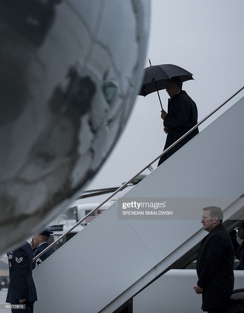 US President Barack Obama walks off Air Force One at Andrews Air Force Base 26, 2013 in Maryland. Obama painted a devastating picture of looming government budget cuts, at a fabled shipbuilding yard in Virginia that provides the US Navy's nuclear powered aircraft carriers. The trip will intensify the president's effort to hike pressure on Republicans to agree on tax increases to avert $85 billion in automatic spending cuts this year, which experts warn could stagger the fragile economy. The White House said the cuts, known as 'the sequester' which are due to hit on March 1, would see 90,000 civilian defense workers furloughed in Virginia alone and would hurt companies in 50 states that supply shipbuilders. AFP PHOTO/Brendan SMIALOWSKI