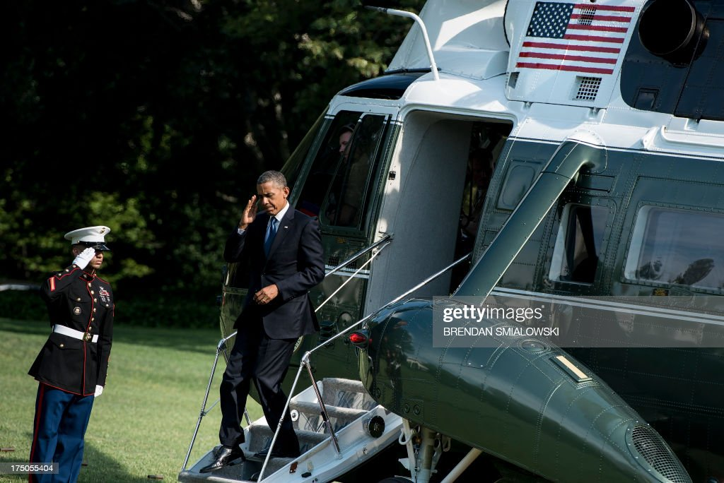 US President <a gi-track='captionPersonalityLinkClicked' href=/galleries/search?phrase=Barack+Obama&family=editorial&specificpeople=203260 ng-click='$event.stopPropagation()'>Barack Obama</a> walks off Marine One on the South Lawn of the White House on July 30, 2013 in Washington. Obama was returning from a day trip to Tennessee where he toured an Amazon Fulfillment Center. AFP PHOTO/Brendan SMIALOWSKI