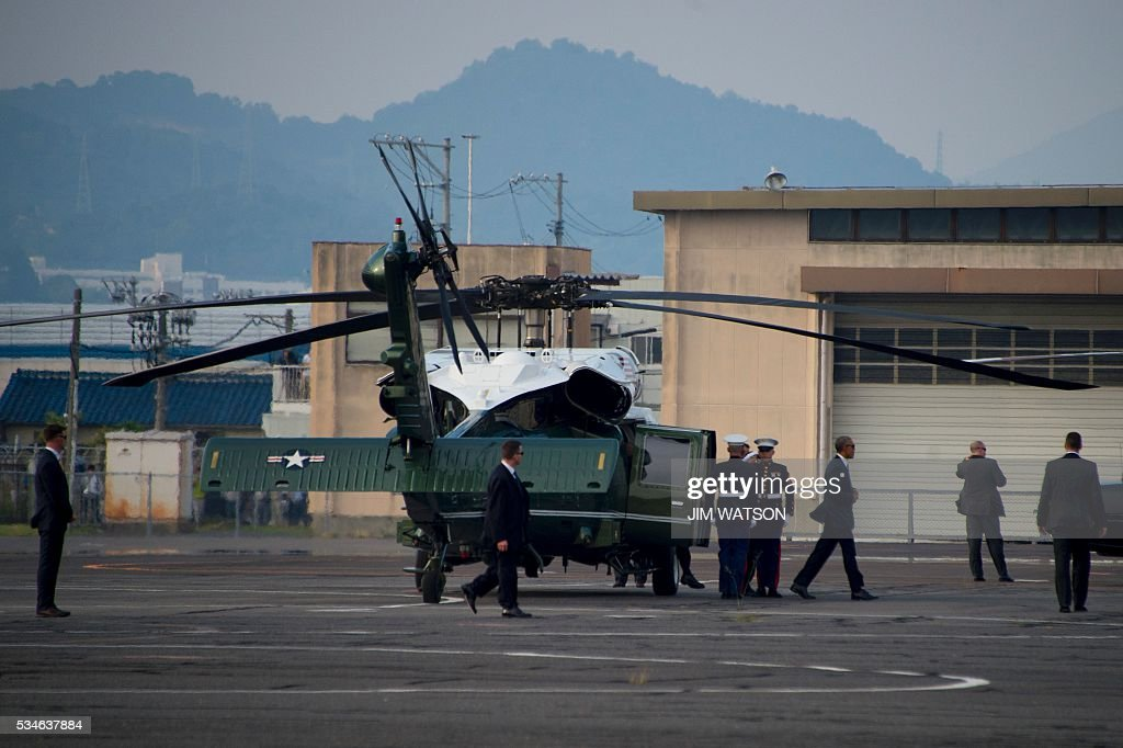 US President Barack Obama (3rd R) walks off Marine One upon landing in Hiroshima on May 27, 2016, enroute to the Hiroshima Peace Memorial Park to lay a wreath. Obama was on the verge of making history on May 27 as he readied to visit Hiroshima -- and become the only sitting US leader to set foot on ground that was seared by the world's first nuclear attack. / AFP / JIM