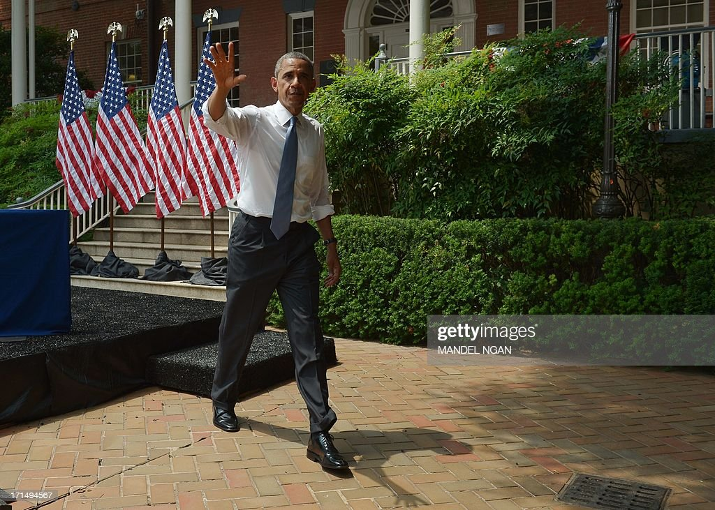 US President <a gi-track='captionPersonalityLinkClicked' href=/galleries/search?phrase=Barack+Obama&family=editorial&specificpeople=203260 ng-click='$event.stopPropagation()'>Barack Obama</a> walks off stage after speaking on climate change on June 25, 2013 at Georgetown University in Washington, DC. AFP PHOTO/Mandel NGAN