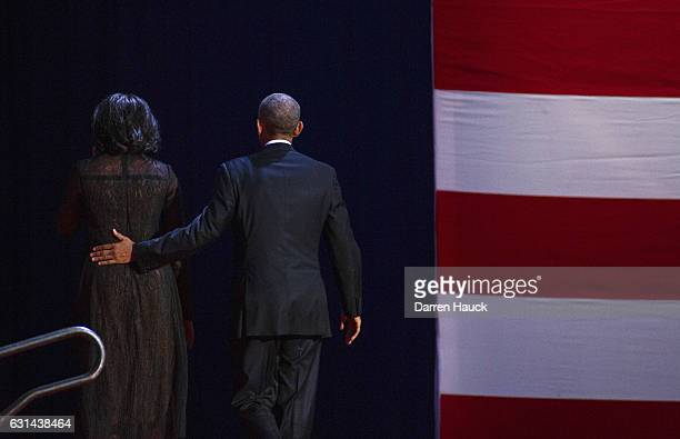 S President Barack Obama walks off stage with first lady Michelle Obama after delivering his farewell speech at McCormick Place on January 10 2017 in...