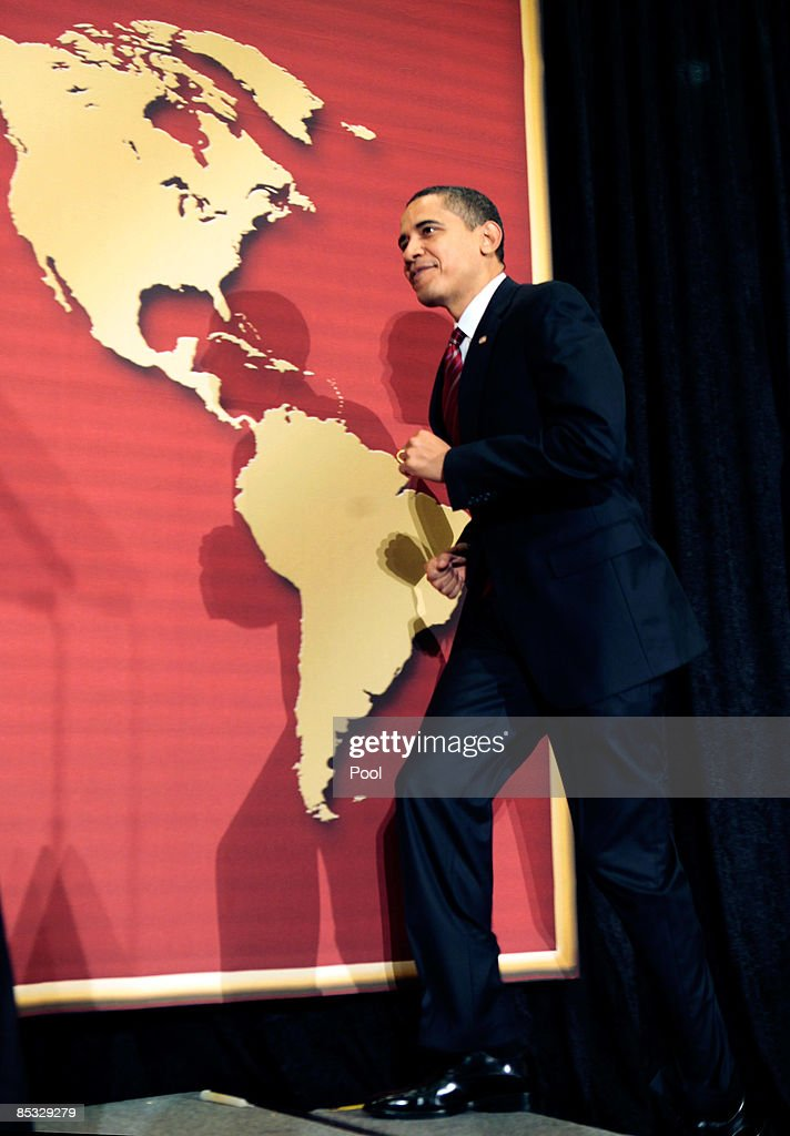 US President Barack Obama walks on stage to deliver remarks at the US Hispanic Chamber of Commerce's 19th Annual Legislative Conference at the...