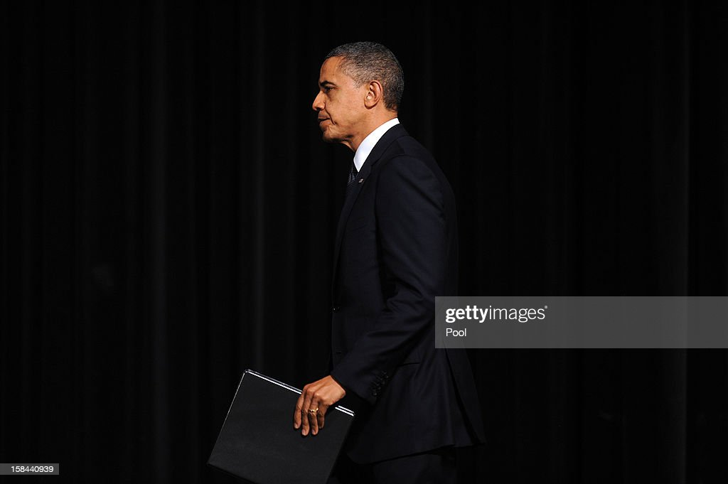 U.S. President <a gi-track='captionPersonalityLinkClicked' href=/galleries/search?phrase=Barack+Obama&family=editorial&specificpeople=203260 ng-click='$event.stopPropagation()'>Barack Obama</a> walks on stage to speak at an interfaith vigil for the shooting victims from Sandy Hook Elementary School on December 16, 2012 at Newtown High School in Newtown, Connecticut. Twenty-six people were shot dead, including twenty children, after a gunman identified as Adam Lanza opened fire at Sandy Hook Elementary School. Lanza also reportedly had committed suicide at the scene. A 28th person, believed to be Nancy Lanza, found dead in a house in town, was also believed to have been shot by Adam Lanza.