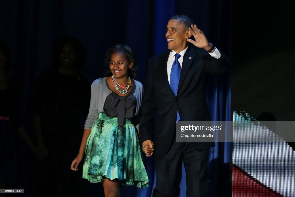 U.S. President Barack Obama walks on stage with daughter Sasha to deliver his victory speech on election night at McCormick Place November 6, 2012 in Chicago, Illinois. Obama won reelection against Republican candidate, former Massachusetts Governor Mitt Romney.