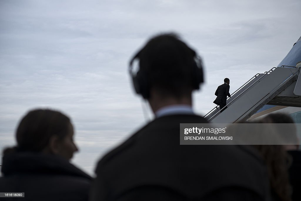 US President Barack Obama walks onto Air Force One at Andrews Air Force Base February 13, 2013 in Maryland. Obama is traveling to North Carolina to visit the Linamar factory to push is economic growth plan he spoke about in last night's State of the Union address. AFP PHOTO/Brendan SMIALOWSKI