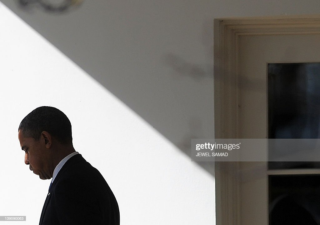 US President Barack Obama walks out of the Oval Office to board the Marine One helicopter to leave the White House in Washington, DC, on Febraury 23, 2012 en route to Miami, Florida. AFP Photo/Jewel Samad