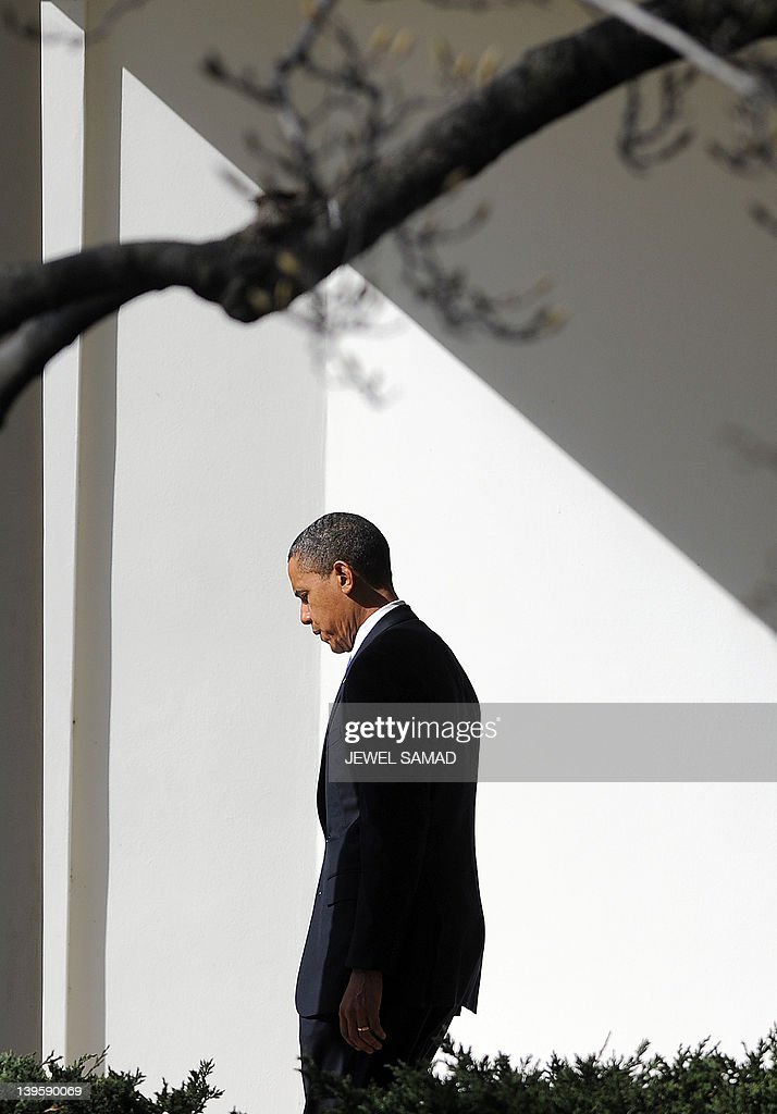 US President <a gi-track='captionPersonalityLinkClicked' href=/galleries/search?phrase=Barack+Obama&family=editorial&specificpeople=203260 ng-click='$event.stopPropagation()'>Barack Obama</a> walks out of the Oval Office to board the Marine One helicopter to leave the White House in Washington, DC, on Febraury 23, 2012 en route to Miami, Florida. AFP Photo/Jewel Samad