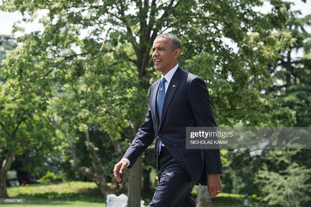 US President Barack Obama walks out of the Oval Office to make a statement on the situation in Iraq on the South Lawn of the White House in Washington on June 13, 2014. Obama said Friday that he is examining options short of sending ground troops to help Iraq counter a Sunni extremist offensive, but warned the country must heal its own divisions. 'We will not be sending US troops back into combat in Iraq, but I have asked my national security team to prepare a range of other options that could help support Iraqi security forces,' Obama said. AFP PHOTO/Nicholas KAMM