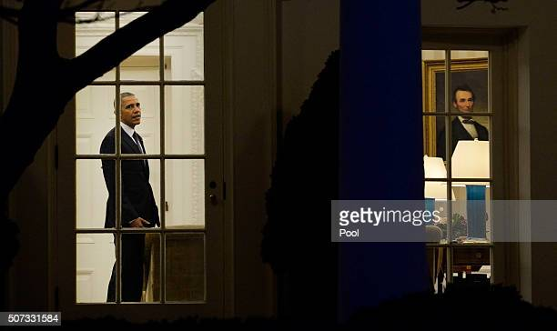 S President Barack Obama walks out of the Oval Office toward the Executive Residence while departing the White House on January 28 2016 in Washington...