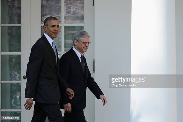 S President Barack Obama walks out of the Oval Office with US Court of Appeals for the District of Columbia Circuit Judge Merrick B Garland Obama's...