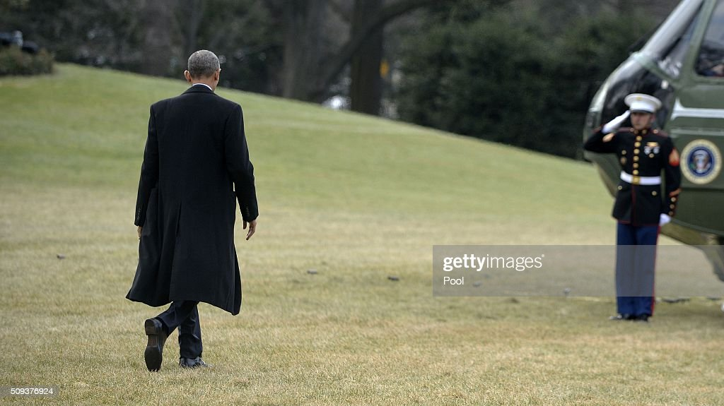 U.S. President Barack Obama walks out of the residence toward Marine One while departing the White House, on February 10, 2016 in Washington, DC. President Obama is traveling to Springfield, Illinois where he will address the Illinois General Assembly.