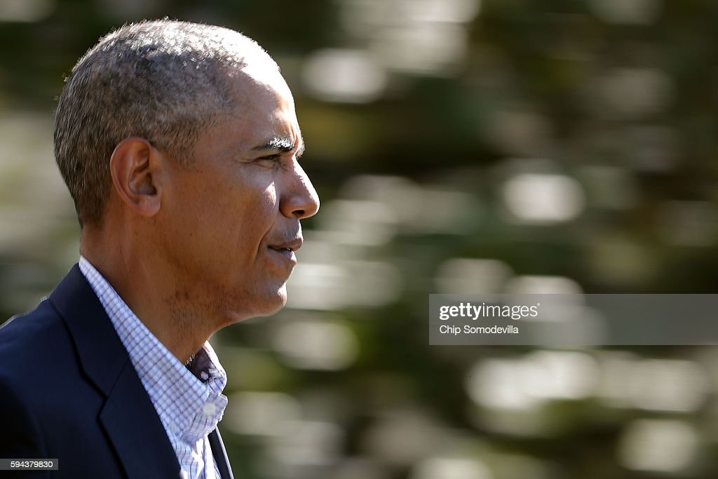 S President Barack Obama walks out of the White House before boarding Marine One and departing August 23 2016 in Washington DC Obama is traveling to...