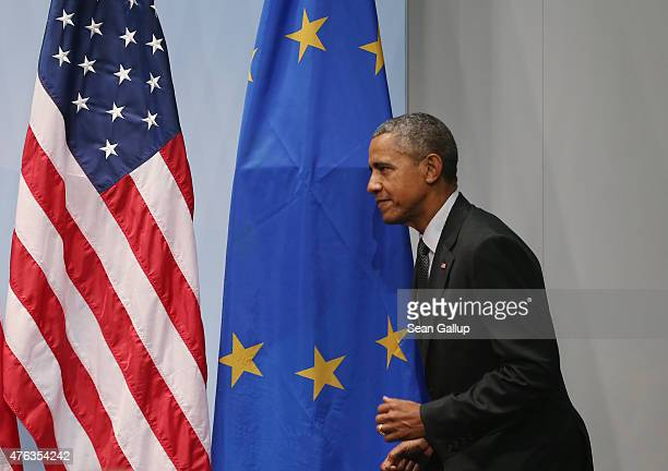 S President Barack Obama walks past a flag of the European Union as he arrives to speak to the media at the conclusion of the summit of G7 nations at...