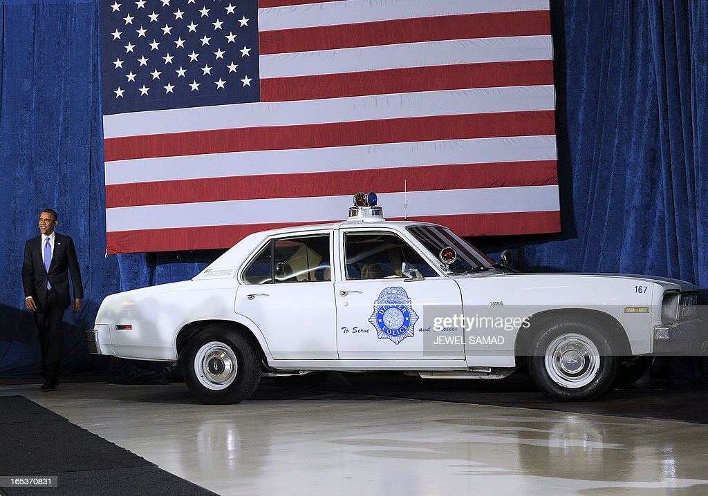 US President Barack Obama walks past an old police car as he arrives to speak on common-sense measures to reduce gun violence at the Denver Police Academy in Denver, Colorado, on April 3, 2013, as he continues asking the American people to join him in calling on Congress to pass common-sense measures to reduce gun violence. The president has demanded votes on measures including a requirement for background checks on all gun purchases, limits on high capacity ammunition magazines, a reinstated assault weapons ban, new gun trafficking laws, and new school safety plans. But the assault weapons ban push appears certain to fail to get sufficient support in the Senate, following a huge campaign by the gun lobby and opposition from Republicans and Democrats from conservative and rural areas. AFP PHOTO/Jewel Samad