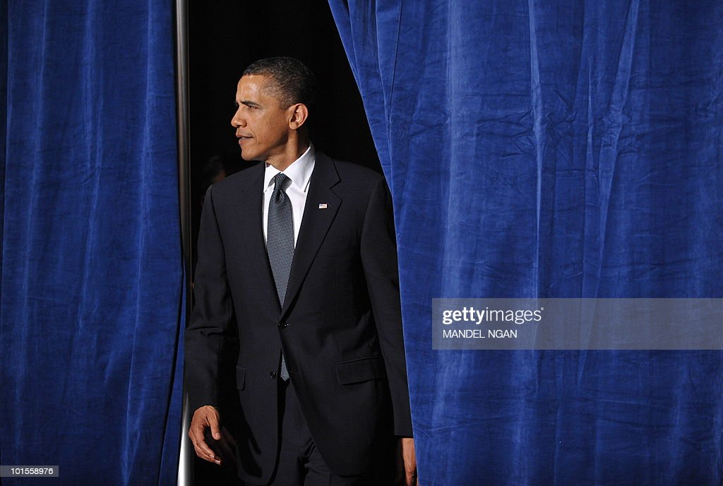 US President Barack Obama walks through a set of curtains to speak at a fundraiser for Senator Barbara Boxer and the Democratic Senatorial Campaign Committee May 25, 2010 at the Fairmont Hotel in San Francisco. AFP PHOTO/Mandel NGAN