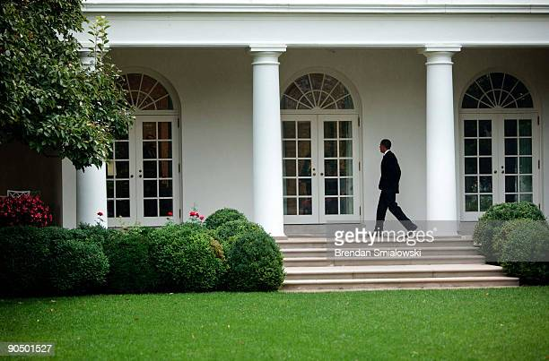 President Barack Obama walks through a West Wing colonnade to the Oval Office of the White House September 9 2009 in Washington DC President Obama is...