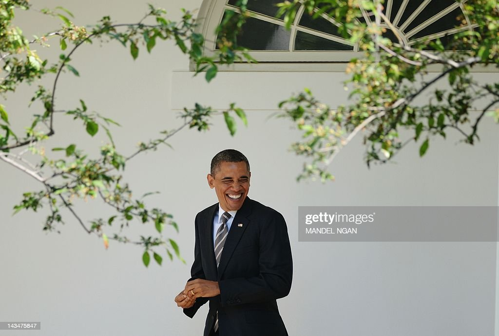 US President Barack Obama walks through the Colonnade before boarding Marine One on April 24, 2012 on the South Lawn of the White House in Washington, DC. Obama is headed to Chapel Hill, North Carolina and Boulder, Colorado to speak on student loans. AFP PHOTO/Mandel NGAN