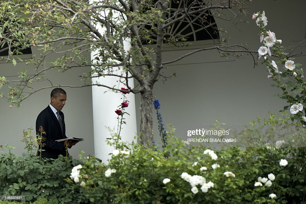 US President Barack Obama walks through the colonnade from the West Wing to the Residence of the White House June 14, 2012 in Washington, DC. Obama is traveling to Ohio for a campaign event before traveling to New York to visit One World Trade Center for a progress update. AFP PHOTO/Brendan SMIALOWSKI