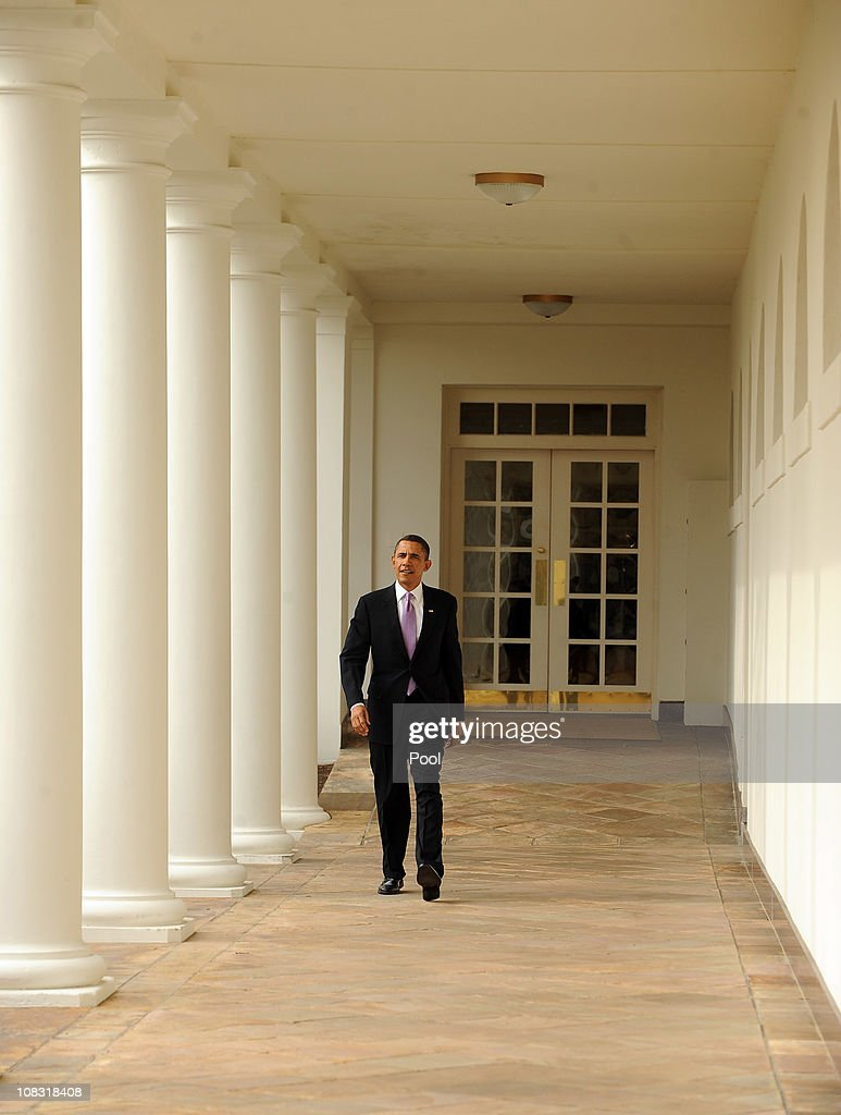 US President Barack Obama walks through the Colonnade of the Rose Garden of the White House on January 25 2011 in Washington DC Later this evening...
