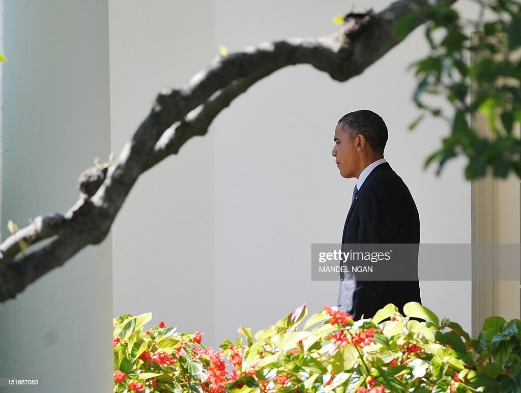 US President Barack Obama walks through the Colonnade on his way to board Marine One September 12, 2012 on the South Lawn of the White House in Washington, DC. Obama was heading to Nevada and Colorado to campaign. AFP PHOTO/Mandel NGAN